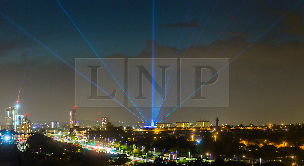 © Licensed to London News Pictures. 23/10/2020. Leeds, UK. Lasers from the Parkinson building at Leeds University light up the Leeds Sky as part of Leeds Light Night which is taking place from the 22nd to the 24th October. The light show has been designed by artist Seb Lee-Delisle & is an interactive display allowing members of the public to control the lasers placed on seven buildings in Leeds using an app on a smartphone or computer. Photo credit: Andrew McCaren/LNP