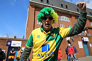 Norwich City fans pose and chants outside Selhurst Park before k/o. Barclays Premier League match, Crystal Palace v Norwich city at Selhurst Park in London on Saturday 9th April 2016. pic by John Patrick Fletcher, Andrew Orchard sports photography.