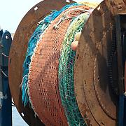 Fishing nets on a reel on a fishing boat in Gloucester Massachusetts harbor