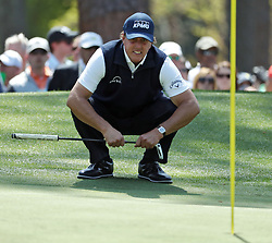 April 6, 2018 - Augusta, GA, USA - Phil Mickelson lines up his putt on six during the second round of the Masters Tournament Friday, April 6, 2018, at Augusta National Golf Club on Friday, April 6, 2018, in Augusta, Ga. (Credit Image: © Jason Getz/TNS via ZUMA Wire)