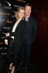 EVA HERZIGOVA and GREGORIO MARSIAJ at a dinner hosted by Liberatum to honour Francis Ford Coppola held at the Bulgari Hotel & Residences, 171 Knightsbridge, London on 17th November 2014.