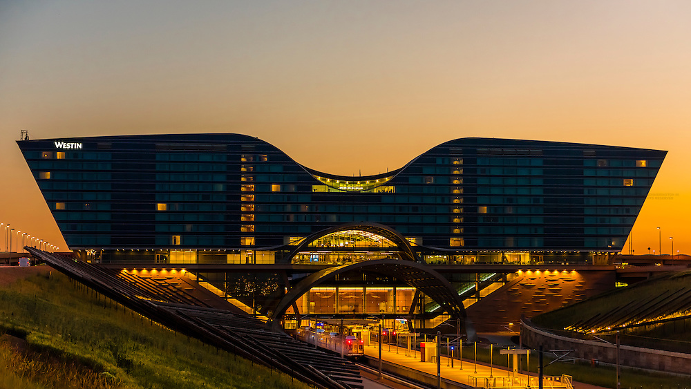 The train station at Denver International Airport at sunrise, Denver, Colorado USA. The RTD Train to the Plane connects the airport with Denver Union Station in Downtown Denver. Westin DIA Hotel in background.