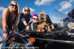 Mandy and Shelly Rossmeyer with Karen Davidson (L-R) and Skyler Keim-Jones, a Florida MDA goodwill ambassador, in a Harley sidecar during Annual MDA Ladies Run to Destination Daytona sponsored by Harley-Davidson every year on the Tuesday of Daytona Beach Bike Week. FL, USA. March 10, 2015.  Photography ©2015 Michael Lichter.