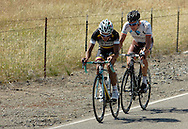 Breakaway riders Fabio Andres Duarte Arevalo (Colombia-Coldeportes), left, and Nicolas Roche (AG2R La Mondiale).make their way along Cross Road in Livermore, Cailf., just moments ahead of the peloton on Tuesday, May 15, 2012. Peter Sagan (Liquigas-Cannondale) won the stage. The 115.8-mile race started this morning in San Jose and took riders through Livermore, Danville, Walnut Creek, Clayton and eastern Contra Costa County before returning to Livermore for the downtown finish line. Riders also traversed Mount Diablo. The race began in Santa Rosa on May 13 and ends Sunday in Los Angeles.  (Cindi Christie/Staff)