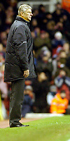 Photo: Leigh Quinnell.<br /> Arsenal v Portsmouth. The Barclays Premiership.<br /> 28/12/2005. Arsenal manager Arsene Wenger looks on.