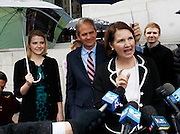 Elizabeth Smart, left, and her father Ed Smart, center look on as Elizabeth's mother Lois Smart talks to the media outside federal court following the guilty verdict in the Brian David Mitchell trial Friday, Dec. 10 2010 in Salt Lake City. Mitchell was found guilty for the June 5 2002 kidnapping of Elizabeth Smart. (AP Photo/Colin E Braley)