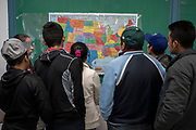 Migrants from different Central American countries talk about the different locations in the United States they will travel to before departing Immaculate Heart of Mary Cathedral in Las Cruces, New Mexico on February 15, 2019.