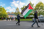 Leicester, United Kingdom, May 19, 2021: A man holds a Palestinian flag outside Elbit UAV Tactical Systems factory, In response to Israeli air raids in Gaza, activists from Palestine Action occupied the rooftop of the Meridian Business Park in Braunstone Town, Leicester on Wednesday, May 19, 2021. (Photo by Vudi Xhymshiti/VXP)