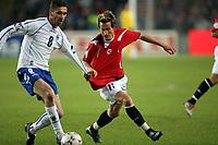 Fotball , 24 mars 2007 , EM - kvalifisering gruppe c, Norge – Bosnia , Norway <br /> Morten Gamst Pedersen , Norge og Dario Damjanovic , Bosnia
