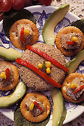 """Ahuautle Amona"": cream cheese cakes coated with ahuauatles (fly larvae from Lake Texcoco)) prepared by Julieta Ramos-Elorduy, an entomologist in her Mexico City kitchen. She created a cookbook of recipes using insects. Mexico City, Mexico. Image from the book project Man Eating Bugs: The Art and Science of Eating Insects."