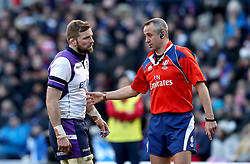 Scotland's John Barclay (left) speaks to match referee John Lacey (right) during the NatWest 6 Nations match at BT Murrayfield, Edinburgh.