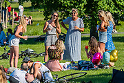 Jumping the gun on, and exceding, the new rules for meeting groups that come into force tomorrow - People enjoy the sun in Brockwell Park after the Government eased restrictions and allowed people to meet. The eased 'lockdown' continues for the Coronavirus (Covid 19) outbreak in London.