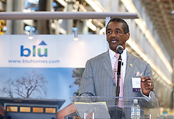 Vallejo Mayor Osby Davis addresses the crowd as Blu Homes opens their West Coast factory on Mare Island in Vallejo, California Dec. 1, 2011.  Over 400 guests attended a ribbon cutting ceremony at the 250,000-square-foot facility.