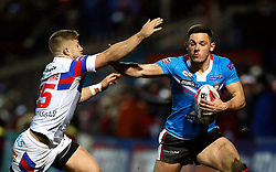Salford Red Devils' Niall Evalds is tackled by Wakefield Trinity's Ryan Hampshire during the Betfred Super League match at Belle Vue Stadium, Salford.