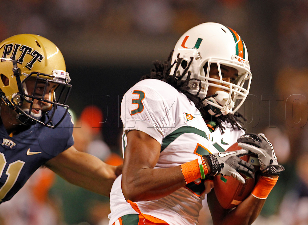 Miami Hurricanes wide receiver Travis Benjamin (3) pulls in a long pass in the first quarter during The University of Miami  vs The University of Pittsburgh Panthers at Heinz Field in Pittsburgh, PA, on Thursday, September 23, 2010.