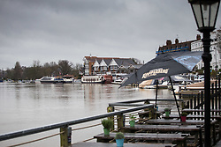 A pub's deck that could be full of customers enjoying a spring bank holiday lies forlorn as the rising waters of the River Thames at Henley, Oxfordshire, flow past. Heavy rains in the River Thames catchment area and saturated ground causes the river to rise to within inches of bursting its banks.. April 02 2018.