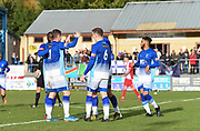 Fellow team players are rushing over to Liam Hughes of Matlock Town to celebrate his  goal during the Northern Premier League match between Matlock FC and Ashton United at the Proctor Cars Stadium on October 10th, 2020 in Matlock, Derbyshire. Local fans welcomed to watch the match maintaining Government's Covid-19 guidelines. (VXP Photo/ Shaun Hardwick)