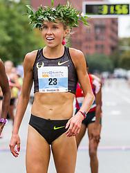 Tufts Health Plan 10K for Women Jordan Hasay wears winner's laurel wreath after running 31:38