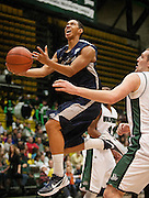 Utah State guard Marcel Davis (0) shoots a layup during the first half of the NCAA basketball game between UVU and Utah State in the UCCU center in Orem, Saturday, Dec. 15, 2012.