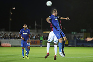 AFC Wimbledon striker James Hanson (18) winning header during the EFL Carabao Cup 2nd round match between AFC Wimbledon and West Ham United at the Cherry Red Records Stadium, Kingston, England on 28 August 2018.