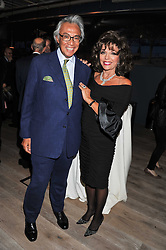 SIR DAVID TANG and JOAN COLLINS at a party to celebrate the publication of her  autobiography - The World According to Joan, held at the British Film Institute, South Bank, London SE1 on 8th September 2011.