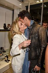Ashley Roberts and Hugo Taylor at a party to launch Ashley Robert's new footwear range Allyn held ay Larizia, 74 St.John's Wood High Street, London England. 8 February 2017.