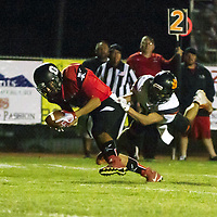 Pirates wide receiver Adrian Ortega (40) breaks a tackle by Johnathan Garcia (26) for a Pirates touchdown to make it 7-7 before halftime in Grants Friday night.