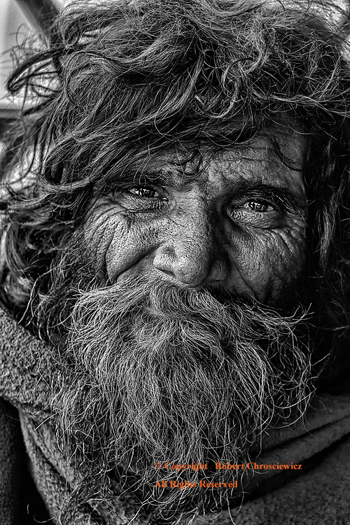 Kind Reflection (B&W): Out from a full head of hair emerges the thoughtful expression of a poor man in Mymensingh Bangladesh.