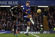 Wilfred Ndidi of Leicester City (L) clears the ball from Marcus Alonso of Chelsea (R). Premier League match, Chelsea v Leicester City at Stamford Bridge in London on Saturday 13th January 2018.<br /> pic by Steffan Bowen, Andrew Orchard sports photography.