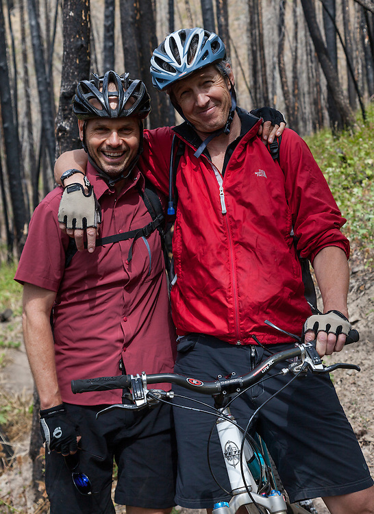 Two Mountain Biking Buddies on the Sun Valley Baldy Mountain Single Track Trail with big grins.  Licensing and Open Edition Prints.