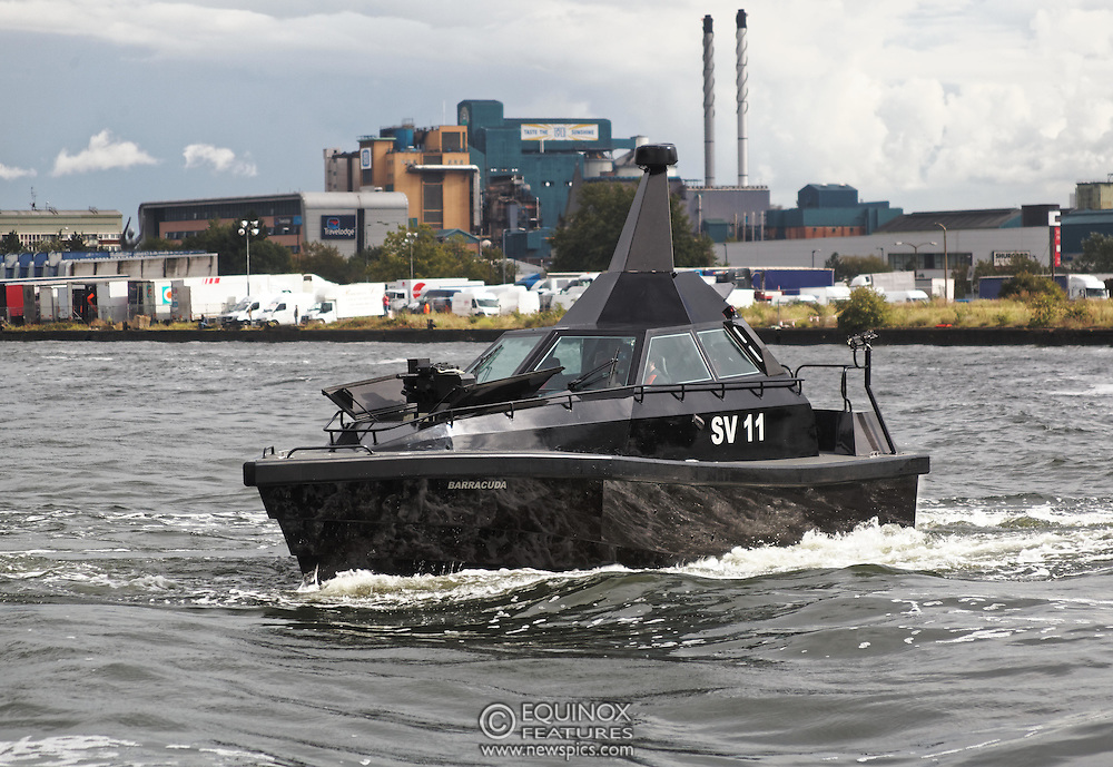 London, United Kingdom - 18 September 2015<br /> Safehaven Marine demonstrate their SV11 Barracuda stealth boat with front mounted retractable gun and radar avoidance technology at Operation MARICAP waterborne demonstration at the defence and security exhibition DSEI at ExCeL, Woolwich, London, England, UK.<br /> (photo by: EQUINOXFEATURES.COM)<br /> <br /> Picture Data:<br /> Photographer: Equinox Features<br /> Copyright: ©2015 Equinox Licensing Ltd. +448700 780000<br /> Contact: Equinox Features<br /> Date Taken: 20150918<br /> Time Taken: 14343517<br /> www.newspics.com