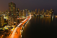 The skyscrapers of Panama City at twilight with Panama Bay in the foreground, Panama City, Panama