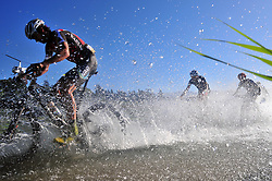 ROBERTSON, SOUTH AFRICA - MARCH 20: Africa jersey wearer Matt Beers leads riders through a river crossong during stage two's 110km from Robertson on March 20, 2018 in Cape Town, South Africa. Mountain bikers from across South Africa and internationally gather to compete in the 2018 ABSA Cape Epic, racing 8 days and 658km across the Western Cape with an accumulated 13 530m of climbing ascent, often referred to as the 'untamed race' the Cape Epic is said to be the toughest mountain bike event in the world. (Photo by Dino Lloyd)