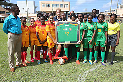 Prince Harry is presented with a shirt from the Grenada Football Association during a community sports event at Queens Park Grounds in Grenada, during the second leg of his Caribbean tour.