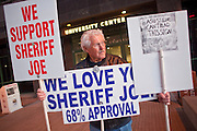 """Nov. 30, 2009 -- PHOENIX, AZ: A supporters of Sheriff Joe Arpaio protests against illegal immigration at the Walter Cronkite School of Journalism and Mass Communication at Arizona State University in Phoenix, AZ. The event was billed as a """"Meet the Press"""" type interview with controversial Maricopa County Sheriff Joe Arpaio. Arpaio was questioned by three members of the faculty, all former journalists. About 3/4 of the way through the one hour program, protestors opposed to Sheriff started singing and effectively shut down the program forcing the sheriff to leave early.   Photo by Jack Kurtz"""