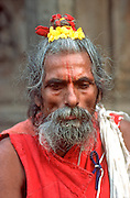 INDIA, RELIGION, HINDUISM Portrait of a Sadhu or Hindu holy man, a pilgrim to Benares (Varanasi) to bathe in the sacred Ganges River