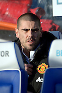 Goalkeeper Victor Valdes of Manchester United looks on from the dugout. Barclays Premier league match, Queens Park Rangers v Manchester Utd at Loftus Road in London on Saturday 17th Jan 2015. pic by John Patrick Fletcher, Andrew Orchard sports photography.