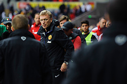 Man Utd Manager David Moyes (SCO) looks calm as he is surrounded after his side win the match  4-1 - Photo mandatory by-line: Rogan Thomson/JMP - Tel: Mobile: 07966 386802 17/08/2013 - SPORT - FOOTBALL - Liberty Stadium, Swansea -  Swansea City V Manchester United - Barclays Premier League - First round of the 2013/14 season and the first league match for new Man Utd manager David Moyes.