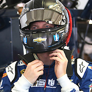 Sprint Cup Series driver Dale Earnhardt Jr. (88) puts his helmet on in the garage area during the 57th Annual NASCAR Coke Zero 400 practice session at Daytona International Speedway on Friday, July 3, 2015 in Daytona Beach, Florida.  (AP Photo/Alex Menendez)