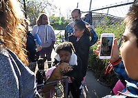 Diana Soto, center, is distraught after losing her RV on Thursday to towing by the city of Salinas. Friends are helping take care of her pets. On Thursday morning, March 24th, under police guard, contractors began to clean out homeless encampments in the Market Way area of Chinatown.