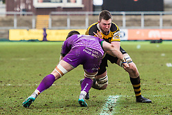 Newport's Joe Bartlett is tackled by Ebbw Vale's Lewis Young - Mandatory by-line: Craig Thomas/Replay images - 04/02/2018 - RUGBY - Rodney Parade - Newport, Wales - Newport v Ebbw Vale - Principality Premiership