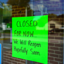 White Horse, PA / USA - May 3, 2020: A closed for now sign posted on a glass window at a small diner in south central Pennsylvania.