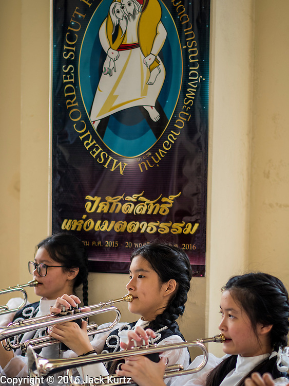 18 SEPTEMBER 2016 - BANGKOK, THAILAND: A high school band performs at Santa Cruz Church before the church's 100th anniversary mass. Santa Cruz Church was establised in 1769 to serve Portuguese soldiers in the employ of King Taksin, who reestablished the Siamese (Thai) empire after the Burmese sacked the ancient Siamese capital of Ayutthaya. The church was one of the first Catholic churches in Bangkok and is one of the most historic Catholic churches in Thailand. The first sanctuary was a simple wood and thatch structure and burned down in the 1800s. The church is in its third sanctuary and was designed in a Renaissance / Neo-Classical style. It was consecrated in September, 1916. The church, located on the Chao Phraya River, serves as a landmark for central Bangkok.       PHOTO BY JACK KURTZ