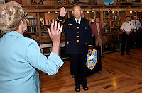 Ann Kaligian swears in Laconia Police Chief Christopher Adams with Laconia Police Commissioner Armand Maheux and retired Chief Michael Moyer looking on at the Freight Room Tuesday morning.  (Karen Bobotas/for the Laconia Daily Sun)Laconia Police Chief Christopher A. Adams' swearing in ceremony at Pitman's Freight Room in Laconia May 31, 2011.Laconia Police Chief Christopher A. Adams' swearing in ceremony at Pitman's Freight Room in Laconia May 31, 2011.  Karen Bobotas/for the Laconia Daily Sun