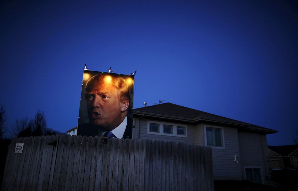 A picture of U.S. Republican presidential candidate Donald Trump hangs outside a house in West Des Moines, Iowa, United States, January 15, 2016.  REUTERS/Jim Young