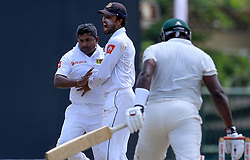 July 14, 2017 - Colombo, Sri Lanka - Sri Lankan captain Dinesh Chandimal(2L) hugs Rangana Herath(L) after Herath dismissed Zimbabwe batsman Hamilton Masakadza during the first day of the only Test cricket match between Sri Lanka and Zimbabwe at ..R Premadasa International Cricket Stadium,in the capital city, Colombo, ..Sri Lanka on Friday 14 th July 2017  (Credit Image: © Tharaka Basnayaka/NurPhoto via ZUMA Press)