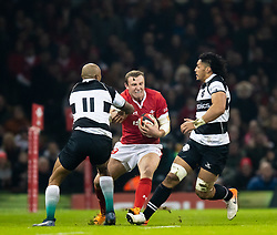 Hadleigh Parkes of Wales under pressure from Cornal Hendricks of Barbarians <br /> <br /> Photographer Simon King/Replay Images<br /> <br /> Friendly - Wales v Barbarians - Saturday 30th November 2019 - Principality Stadium - Cardiff<br /> <br /> World Copyright © Replay Images . All rights reserved. info@replayimages.co.uk - http://replayimages.co.uk