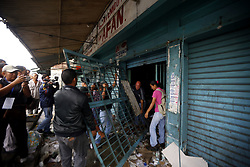 May 3, 2017 - Naguanagua, Carabobo, Venezuela - 19 shops were sacked yesterday by vandal groups that took over the streets and forced doors to ingredsar and loot all the merchandise of the businesses of food, medicine, hardware stores, among others, in the city of Naguanagua, Carabobo state. Photo: Juan Carlos Hernandez (Credit Image: © Juan Carlos Hernandez via ZUMA Wire)
