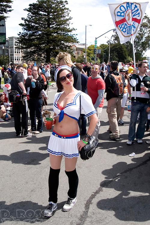 An unidentified woman dressed in a sailor's outfit enjoys a tasty beverage during the 100th running of the Bay to Breakers 12K, Sunday, May 15, 2011 in San Francisco. (Photo by D. Ross Cameron)