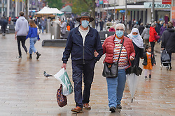 © Licensed to London News Pictures 21/10/2020. Sheffield , UK. Shoppers wear face coverings as they  walk in the city center of Sheffield.  The county of SouthYorkshire will enter into Tier 3 ,from 00:01 on Saturday 24 October. New restrictions will cover Sheffield, Barnsley, Doncaster, Barnsley and Rotherham. Photo credit: Ioannis Alexopoulos/LNP